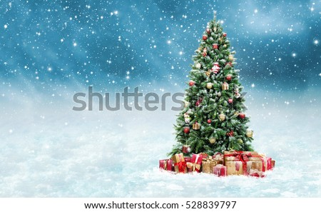 Beautiful christmas tree with golden and red present boxes in a snowy winter landscape #528839797