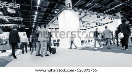 Blurred business people International Tradeshow  Royalty-Free Stock Photo #528891766