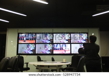 BANGKOK, THAILAND, Dec 1, 2016 - Reporters in The Nation editorial watching HM King Maha Vajiralongkorn ascended the throne as King Rama X on live TV on Thursday night. #528947734