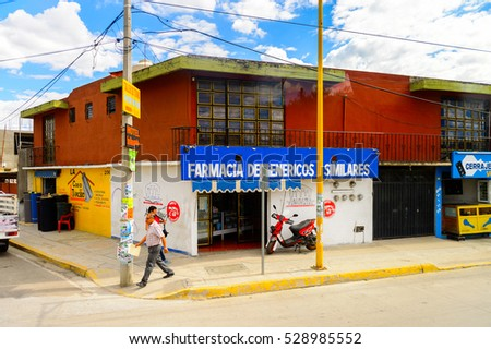 OAXACA, MEXICO - OCT 31, 2016: Typical colorful architecture of Oaxaca de Juarez, Mexico. The name of the town is derived from the Nahuatl name Huaxyacac #528985552