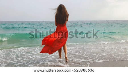 lifestyle photo of woman with perfect hair.walking alone at the beach.Sensual young girl relaxing.Colorful filter.glam style,teen trend outfit, positive mood,smiling,amazing model girl,long hair #528988636