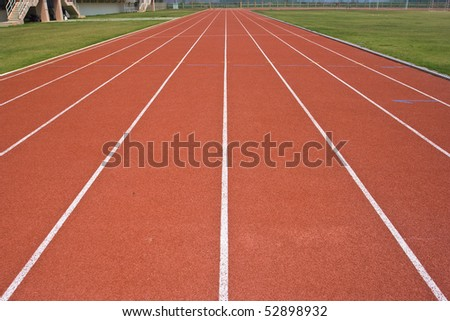 A university running track, around an football field. #52898932