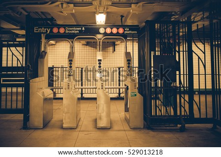 Vintage tone New York City subway turnstile #529013218