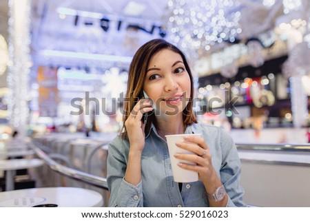 Businesswoman On Phone Using Digital Smartphone In Coffee Shop #529016023