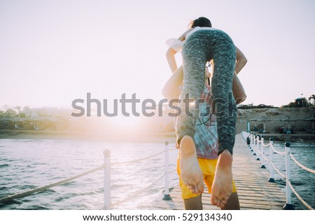 couple in love during the honeymoon. Tropical getaway near the water. Love story of two people in love. Film Texture & Unfocused #529134340