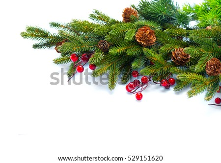 Christmas Tree with Cones border isolated on a White background. New Year holiday evergreen tree, Xmas green art corner design. Branches of fir tree decorated with holly berry and cones. Winter #529151620