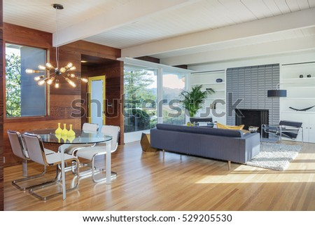 Elegant wooden designer interior with french doors and fire place #529205530