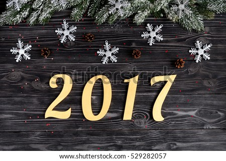 Christmas decorations, spruce branches on dark wooden background top view #529282057