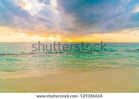 Beautiful sunset with sky over calm sea  in tropical Maldives island #529386664