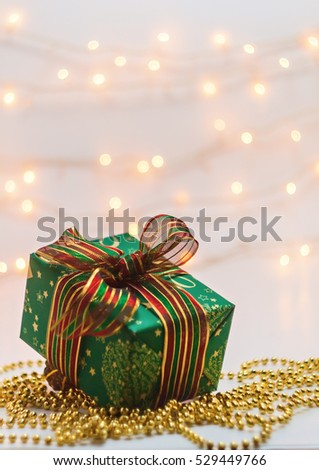 New Year's box with a gift on a background blur lights. #529449766