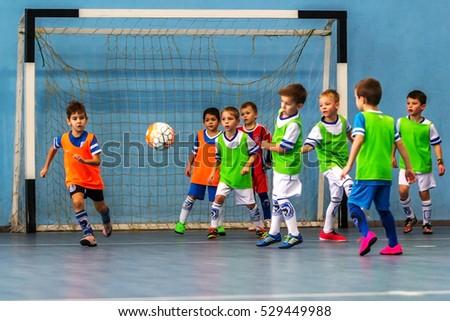 Odessa, Ukraine -December3,2016: Little boys, children play in mini-football in indoor sports hall at Junior championship sports city. Children's sports - healthy lifestyle. Sport children footballers #529449988