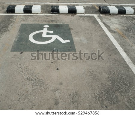Car parking lot with white mark and  on street used warning sign on road. #529467856