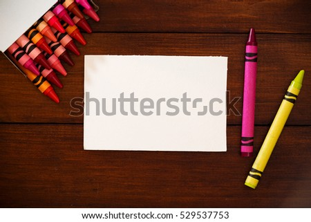 White mock up paper and colorful  crayons.