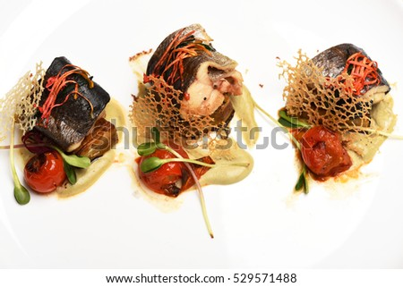 delicious dish of fish with vegetables isolated on white #529571488