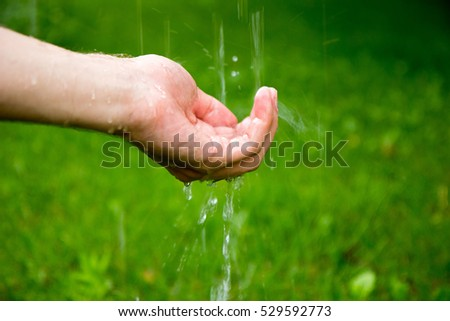 Water being poured on a hand #529592773