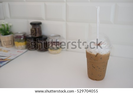 Cold milk coffee and ice in glass #529704055