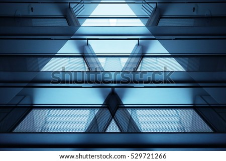 Close-up photo of modern multistory building fragment with balconies and supporting beams. Transparent contemporary architecture in hi-tech / minimalism style. Royalty-Free Stock Photo #529721266