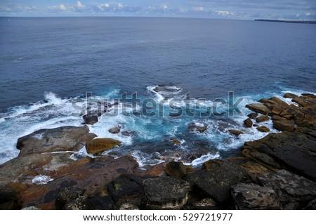Sea shore - ocean wave with rocks at Bondi Beach, Sydney, Australia #529721977