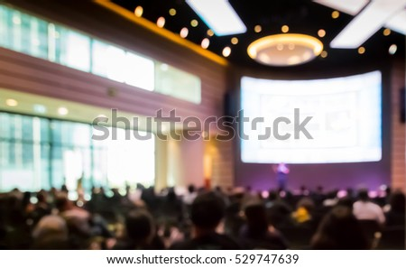 Blurred audience  in auditorium  or  hall with monitor #529747639