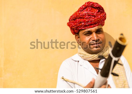 Musician playing traditional rajasthani music on the street of Jaipur, Rajasthan, India #529807561