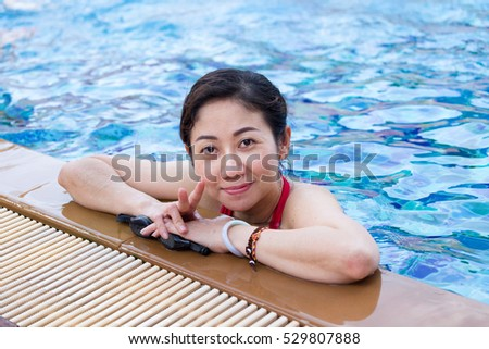 Female swimmer in an indoor swimming pool #529807888