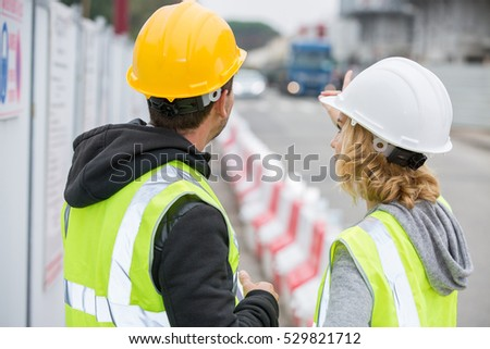 Construction people looking at construction site #529821712