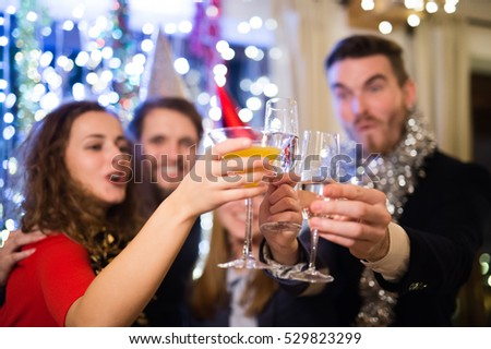 Group of friends having party on New Years Eve. #529823299