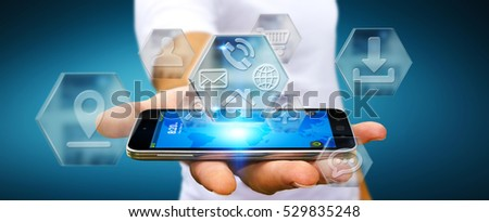 Young man holding mobile phone with application icons interface in his hand 3D rendering #529835248