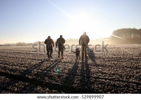 Hunting crew heading out to hunt, early november morning in Denmark. Royalty-Free Stock Photo #529899907