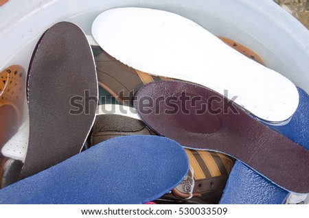 Washing shoes in the basin, wet shoes, cleaning shoes at home #530033509