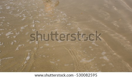 sandy beach place with shallow foany water #530082595