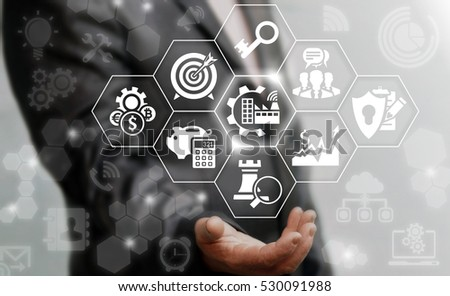 Industry 4.0 business concept. Businessman touched industrial modern gear factory icon on virtual screen on background of network manufacture sign. Manufacturing strategy computing future technology #530091988