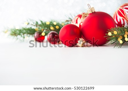 Red christmas ornaments on white background with xmas tree, twinkle bokeh lights. Merry christmas card. Winter holiday xmas theme. Happy New Year. Space for text. #530122699