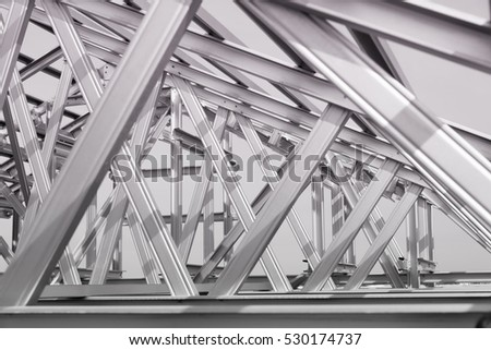 Black and white photo,Structure of steel roof frame for building construction. #530174737