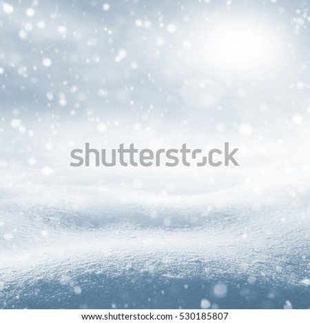 Winter background. Winter bright landscape with snowdrifts and falling snow.