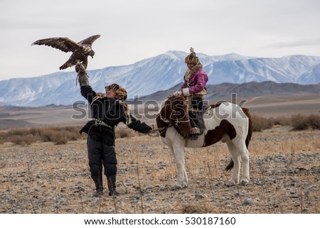 Kazakh Eagle Hunters in traditionally wearing typical Mongolian dress culture of Mongolia