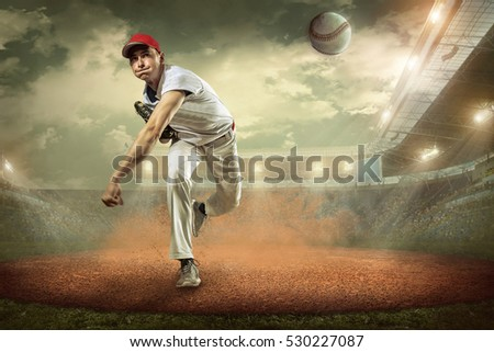 Baseball players in action on the stadium. #530227087