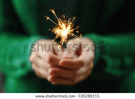 Close up view of hands with sparkler #530280115