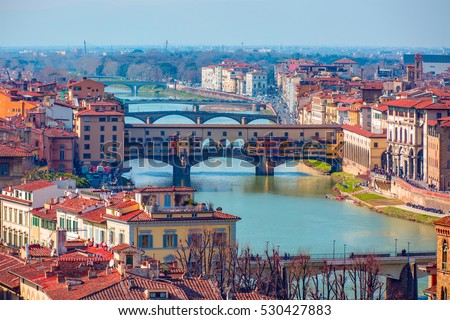 Ponte Vecchio over Arno river in Florence, Italy #530427883