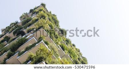 Green futuristic skyscraper, environment and architecture concepts Royalty-Free Stock Photo #530471596