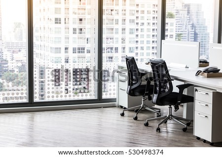 Modern office with open space to work thought the window and background city. #530498374