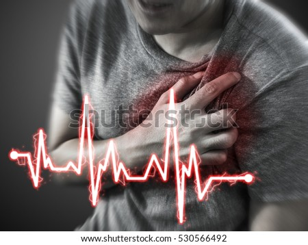 Severe heartache, man suffering from chest pain, having heart attack or painful cramps, pressing on chest with painful expression. Royalty-Free Stock Photo #530566492