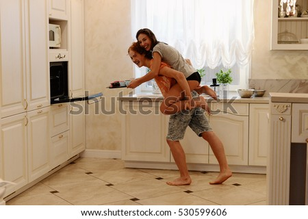 the lovers rejoice and indulge in the kitchen #530599606