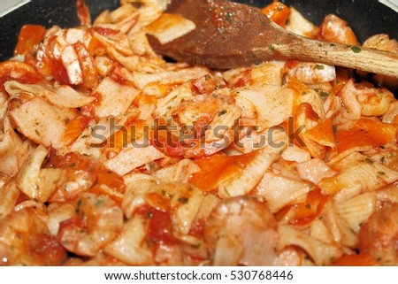 fish sauces with tomato, shrimp, crab meat, shrimp in the pan #530768446