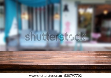 Selected focus empty brown wooden table and Coffee shop or restaurent blur background with bokeh image. for your photomontage or product display #530797702