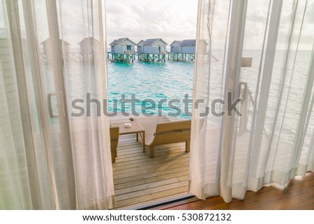 Beautiful tropical Maldives resort hotel with beach and blue water #530872132