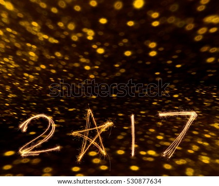 happy new years 2017 fireworks Sparkle alphabet on gold bokeh background. HAPPY NEW YEAR concept. #530877634