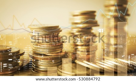 Double exposure of graph and rows of coins for finance and business concept Royalty-Free Stock Photo #530884792