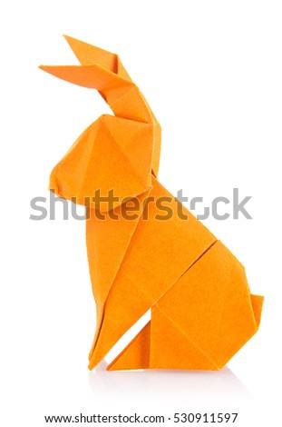 Easter bunny of orange origami. Isolated on white background #530911597