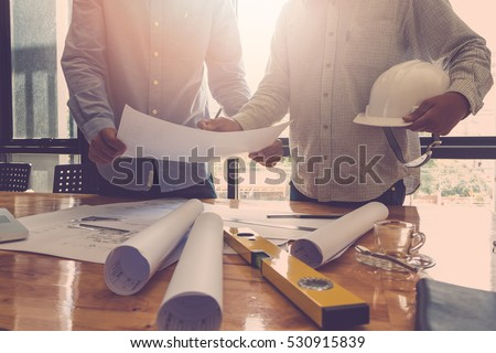 Architect concept, Architects working with blueprints in the office, Vintage Effect Royalty-Free Stock Photo #530915839